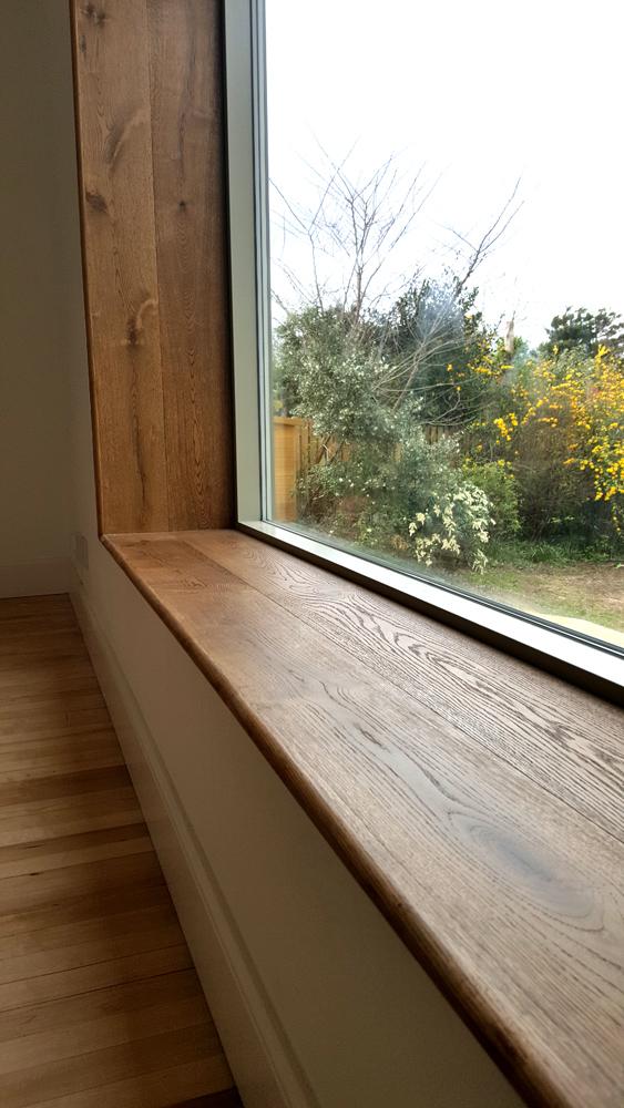 Close-up of the bespoke solid oak window seat in Edinburgh.