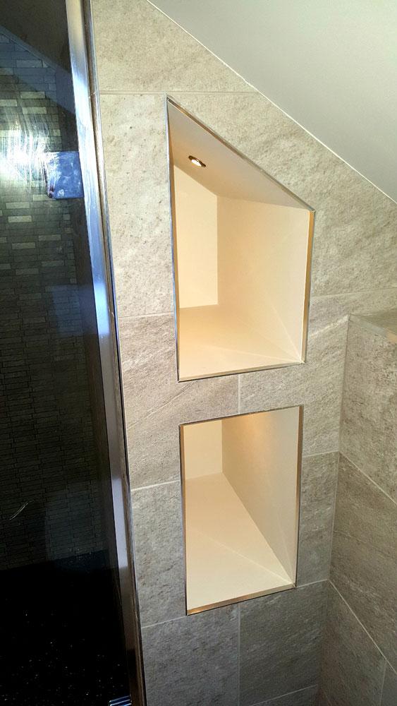 Illuminated towel storage pocket shelves in Cameron Toll.