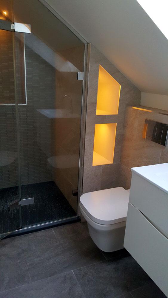 Illuminated storage for a loft en-suite bathroom (Cameron Toll).
