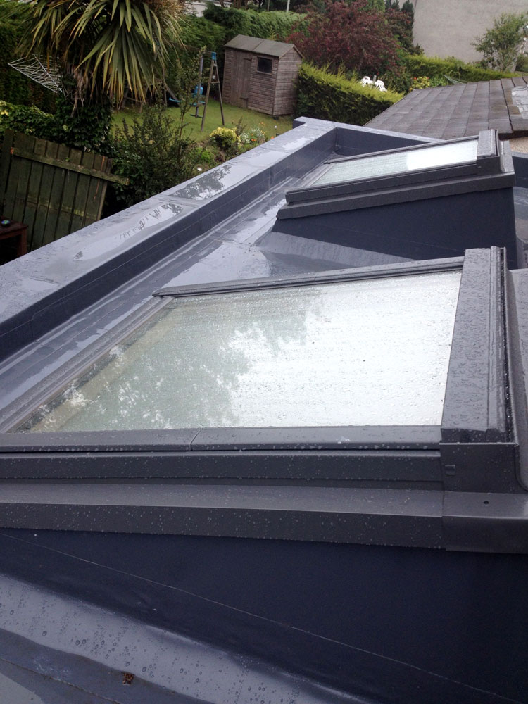 'Sarnafil' roof system with roof light on a new extension in Buckstone.