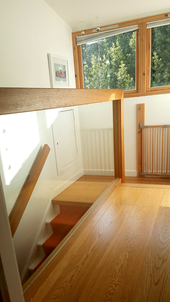 Glass and oak balustrade fitted to a home in Cramond.