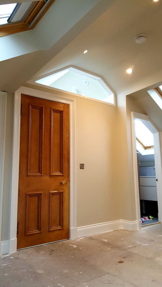 Tailor-made loft door installed in a Cameron Toll house.