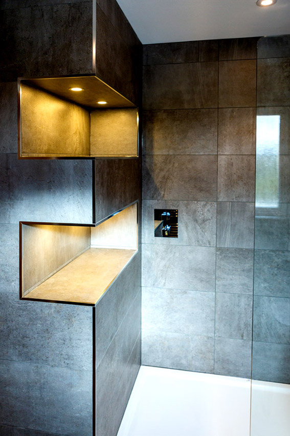 Bespoke bathroom with wall corners removed to make spacious shelves.