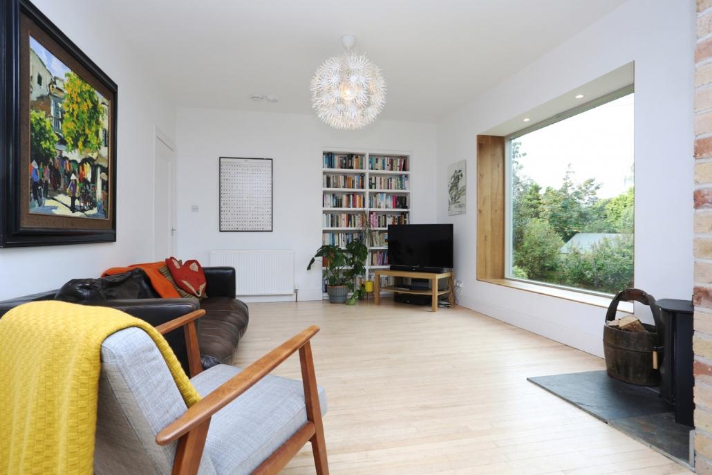 Bespoke bookcase with maple wood floors (Craiglockhart).